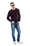 Cool relaxed young man wearing sunglasses and jeans smiling at camera Royalty Free Stock Photos