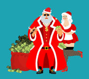 Cool Rich Santa and girl. Red bag with money. Claus with cigar a Royalty Free Stock Image