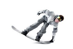 Cool rider. Cool snowboarder doing tailpress, isolated Royalty Free Stock Photo