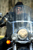 Cool rider on a chopper. Closeup royalty free stock image