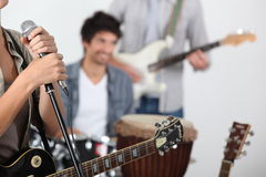 Cool rock band. Practicing together Stock Photos