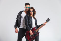 Cool rock and roll couple with electric guitar Stock Images