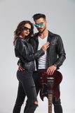 Cool rock and roll couple standing embraced royalty free stock photography