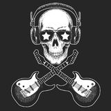 Cool rock star skull wearing disco glasses and headphones Retro music festival. Wings. Heavy metall emblem for concert. Rock music festival. Cool print for Stock Images