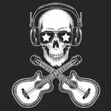 Cool rock star skull wearing disco glasses and headphones Retro music festival. Wings. Heavy metall emblem for concert. Rock music festival. Cool print for Royalty Free Stock Photos