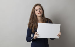 Cool 20s girl with long hair holding a message on white background Stock Photos