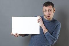 Cool 40s man enjoying making an advertisement in displaying a blank insert Stock Image