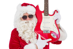 Cool santa showing electric guitar Royalty Free Stock Images