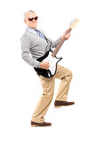 Cool senior playing an electric guitar. Isolated on white background Royalty Free Stock Photo