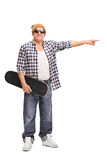 Cool senior skater pointing with his hand Stock Photography