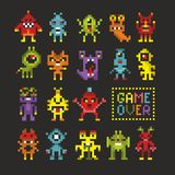 Cool set of 8 bit monsters. Game over banner in vector Royalty Free Stock Images