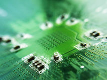 Cool sharpen electronics. On green electronic board stock photos