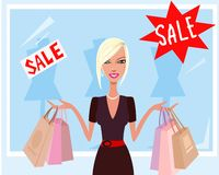 Cool shopping. A happy young woman with several bags Royalty Free Stock Images