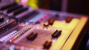 Cool shot of Digital Audio Console Fader by stage during performance stock video footage