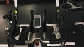 Cool shot of LCD monitor display and handles of a spinning bike stock video footage