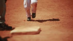Cool shot of little kids running the bases during a baseball game