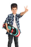 Cool skater boy making a peace sign Stock Images