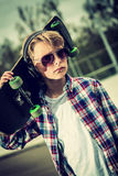 Cool skater. Cool looking skater boy, with sunglasses and headphone vintage effect added stock image