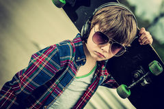 Cool skater. Cool looking skater boy, with sunglasses and headphone vintage effect added stock images