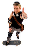 Cool skater showing thumbs up Royalty Free Stock Photos