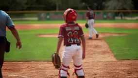 Cool slow motion of baseball player batting. Shot from behind home plate stock video footage
