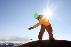 Cool snowboarder against blue sky Royalty Free Stock Photography