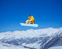 Cool snowboarder in the air Stock Photo