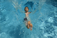 Cool Splash. Boy falling in pool stock photos