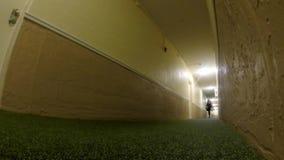 Cool static shot of woman walking down hallway stock video