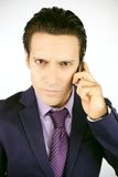 Cool strong business man on the phone Royalty Free Stock Image