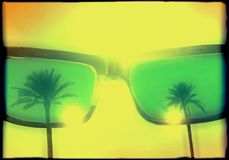 Cool summer grunge poster with palm trees reflecting in sunglasses - summer illustration with copy space for text - stock. Image royalty free illustration