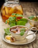 Cool summer tea with mint and ice cubes in a Royalty Free Stock Images