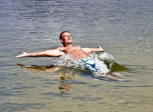 Cool Summer Water Joy. Handsome Athletic Young Man Falling Back In Water Stock Photography