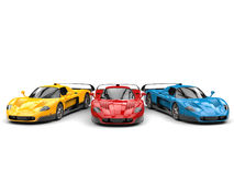 Cool super concept cars in primary base colors with black details. Isolated on white background Royalty Free Stock Image