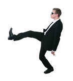Cool teen dancing. Cool young man in suit dancing - isolated on white Royalty Free Stock Image