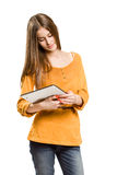Cool teen girl using tablet device. Stock Image