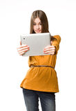 Cool teen girl using tablet device. Stock Photography