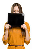 Cool teen girl using tablet device. Royalty Free Stock Image