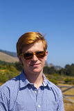 Cool teenage boy with sunglasses Royalty Free Stock Image