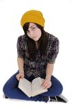 Cool teenage girl reading a book Stock Image