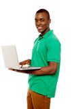 Cool teenage guy surfing internet on laptop Stock Photos