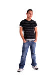 Cool teenager. A handsome teenager standing in front of a white background Stock Photos