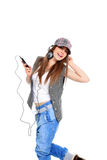 Cool teenager listening to music and dancing Stock Photos
