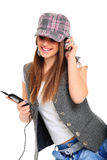 Cool teenager listening to music and dancing Stock Image