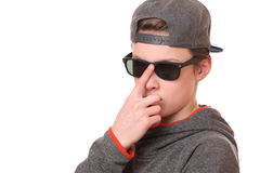 Cool teenager. Portrait of a cool teenage boy wearing sunglasses on white background Royalty Free Stock Photography