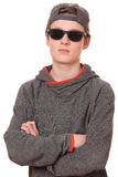 Cool teenager. Portrait of a cool teenage boy wearing sunglasses on white background Royalty Free Stock Images