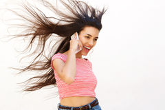 Cool teenager talking on mobile phone Stock Photo