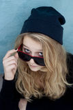 Cool teenager wtih wool hat and sunglasses Stock Photos