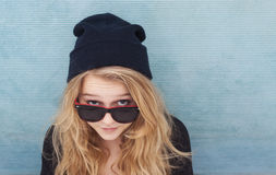 Cool teenager wtih wool hat and sunglasses Stock Photography
