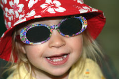 Cool toddler. 2 year old girl with hat and glasses, ready for the beach Stock Images